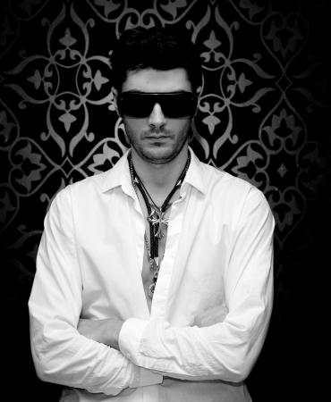 Serious man wearing sunglasses photo