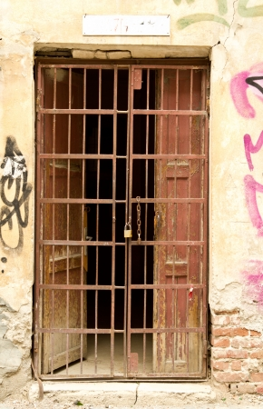 iron bars: Old door with metal grill locked with a chain