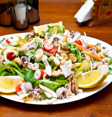 Seafood salad with rucola and lemon juice photo