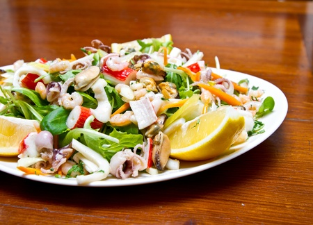 Seafood salad with rucola and lemon juice photo