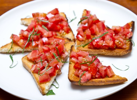 Italian appetizer called bruschetta photo