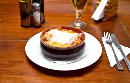 Freshly made lasagna in a traditional bowl photo