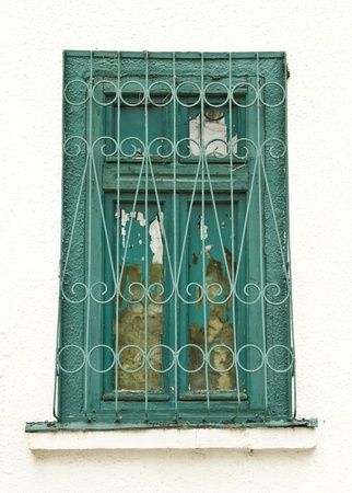 Grungy old window with metal bars Stock Photo - 15537249