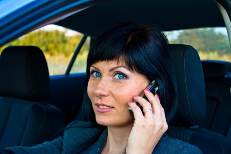 drivers seat: Caucasian woman in the drivers seat