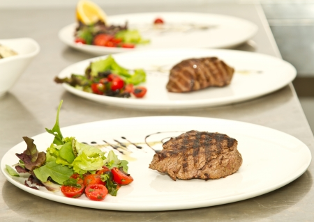 plating: Beef roasting on the grill ( shallow DOF)