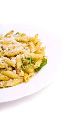 Penne with basil, olive oil and pine dressing (shallow DOF) photo