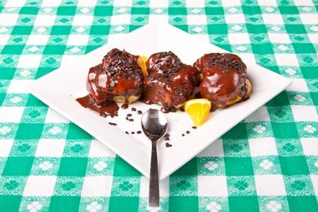 Chocolate baked cakes with orange wedges Stock Photo - 15861863
