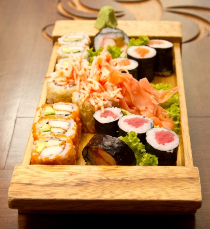 Different kinds of sushi on a wood plate Stock Photo - 15861671