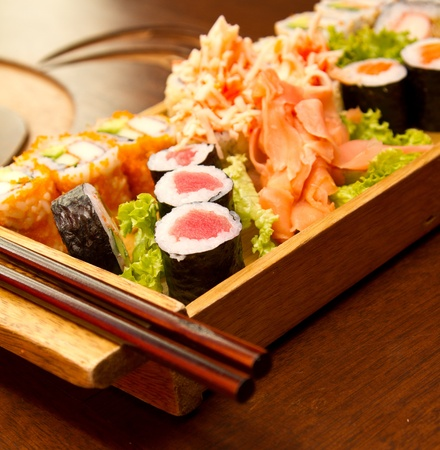 Different kinds of sushi on a wood plate Stock Photo - 15861746