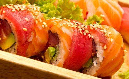 Different kinds of sushi on a wood plate Stock Photo - 15861622