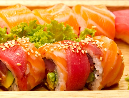 Different kinds of sushi on a wood plate Stock Photo - 15861632
