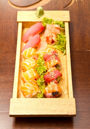 Different kinds of sushi on a wood plate Stock Photo - 15861852