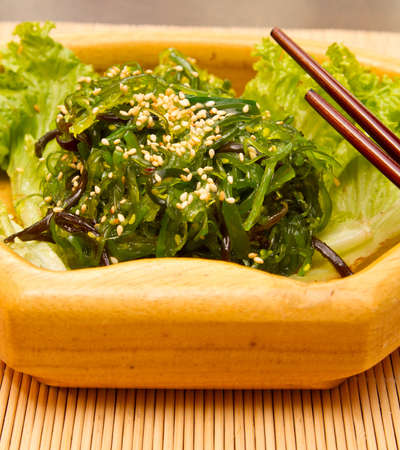 Seaweed salad with sesame seeds photo