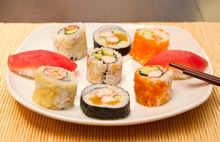 Different kinds of sushi on a plate (focus on middle one) Stock Photo - 15861768