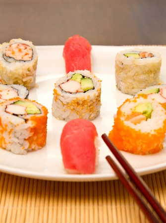 Different kinds of sushi on a plate (focus on middle one) Stock Photo - 15861596