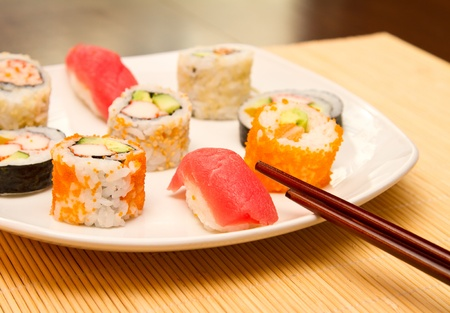 Different kinds of sushi on a plate Stock Photo - 15861775