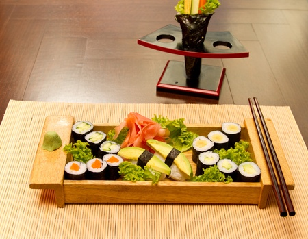 Different kinds of sushi on a wood plate Stock Photo - 15861778