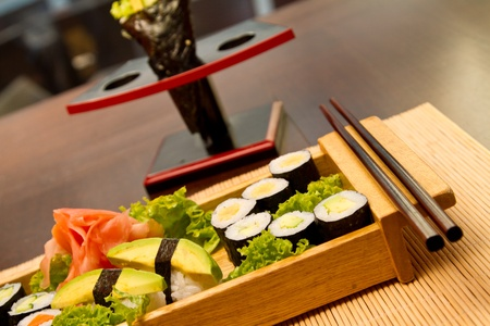 Different kinds of sushi on a wood plate Stock Photo - 15861825