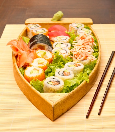 Different kinds of sushi on a wooden plate Stock Photo - 15861737