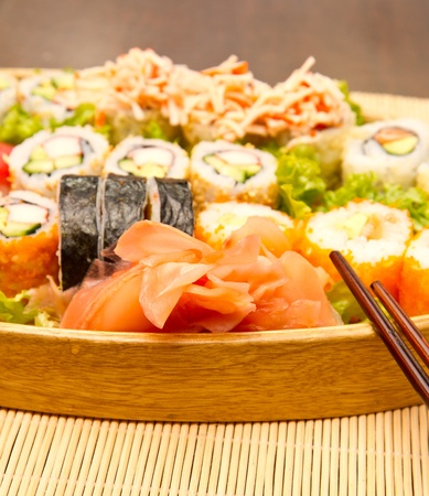 Different kinds of sushi on a wooden plate Stock Photo - 15857179