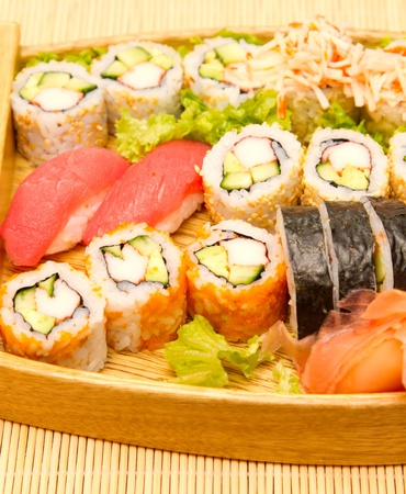 Different kinds of sushi on a wooden plate Stock Photo - 15861753