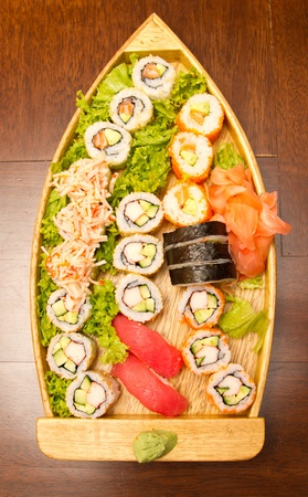 Different kinds of sushi on a wooden plate Stock Photo - 15861886