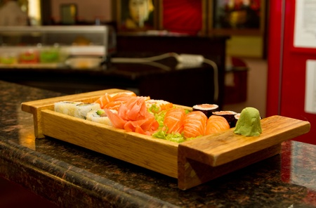 Different kinds of sushi on a wooden plate Stock Photo - 15861761