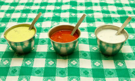 Mint, tomato and cream sauces photo