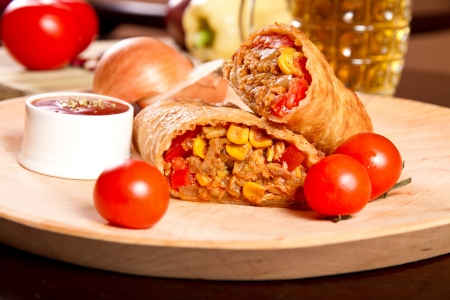 Burrito on a wooden plate