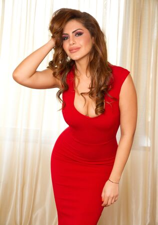 Beautiful model in a sexy red dress photo