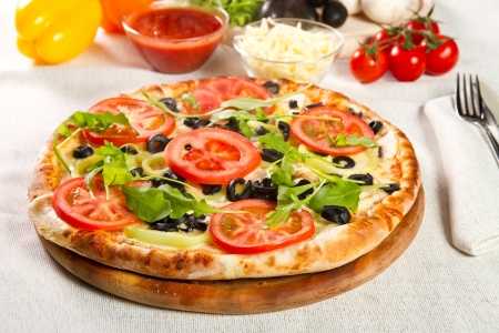 Vegetarian pizza on a wooden board Stok Fotoğraf