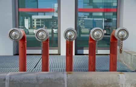 Fire hydrants outside an office bulding photo