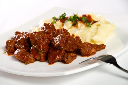 Goulash: Beef stew with mashed potatos Stock Photo