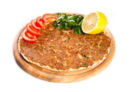 Turkish specialty pizza with parsley and lemon Stok Fotoğraf