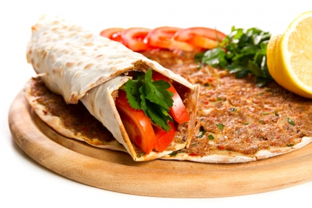 Turkish specialty pizza with parsley and lemon Stock Photo