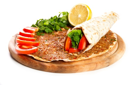 Turkish specialty pizza with parsley and lemon photo