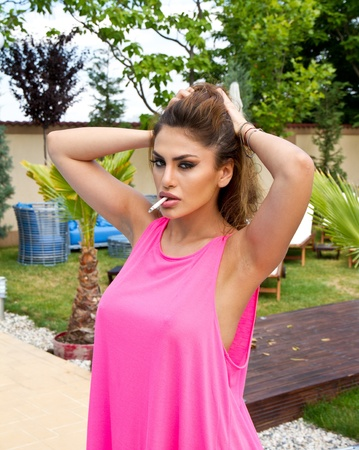 Woman in a sexy pink shirt photo