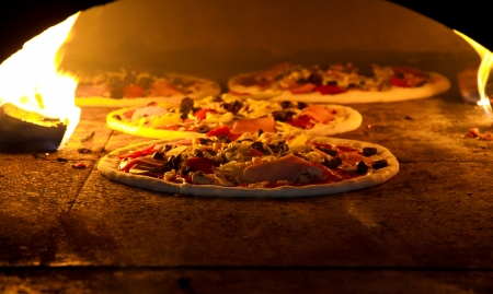 wood burning: Pizza cooking in a tradition oven
