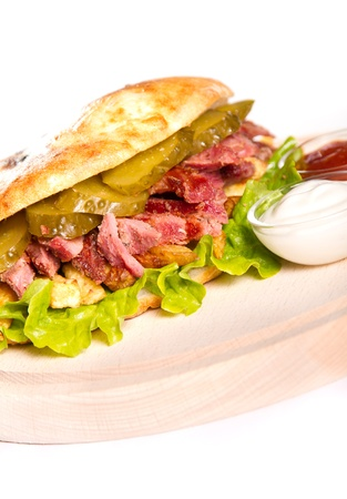 Beef sandwich with pickled cucumbers photo