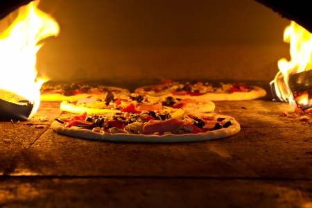 Pizza cooking in a tradition oven photo
