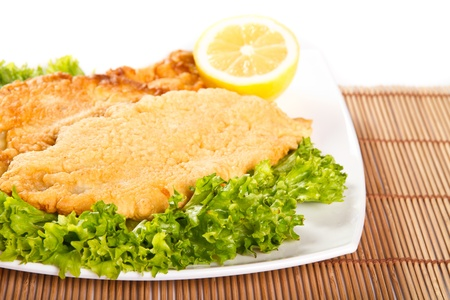 Fried fish fillet with lemon photo
