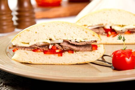 Gourmet beef sandwich with cherry tomato photo