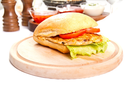 Grilled chicken breast  sandwich with vegetables photo