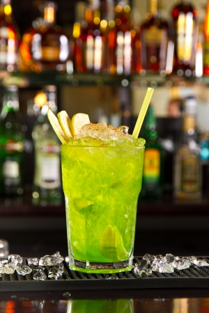 alcohol bottles: Green apple cocktail on the bar counter Stock Photo