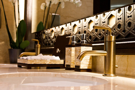 Elegant sinks with marble countertop photo