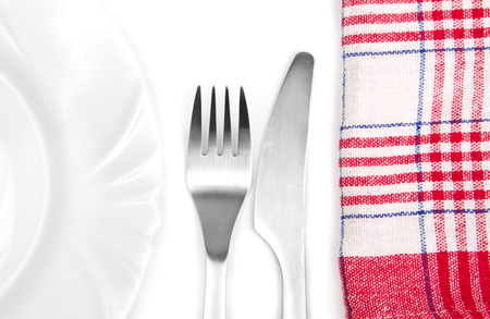 alluminum: Alluminum silverware next to a plate and kitchen towel Stock Photo