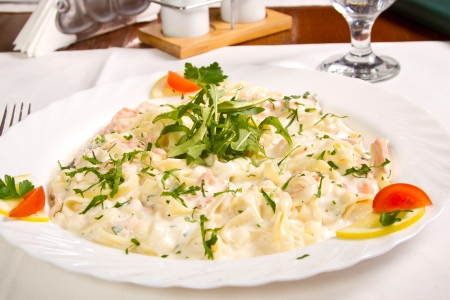 Salmon fettucine with white sauce photo