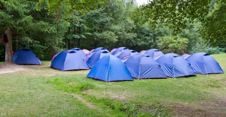 camping site: Camping site with blue tents set up