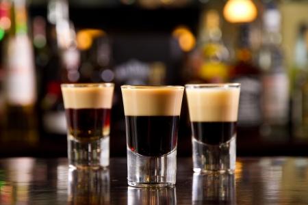 three layered: Three layered shots on a bar counter top
