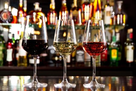 tasting: Three glassses of wine on the counter